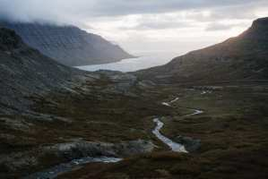 river-inflows-passing-between-mountains-near-big-lake-in-mist
