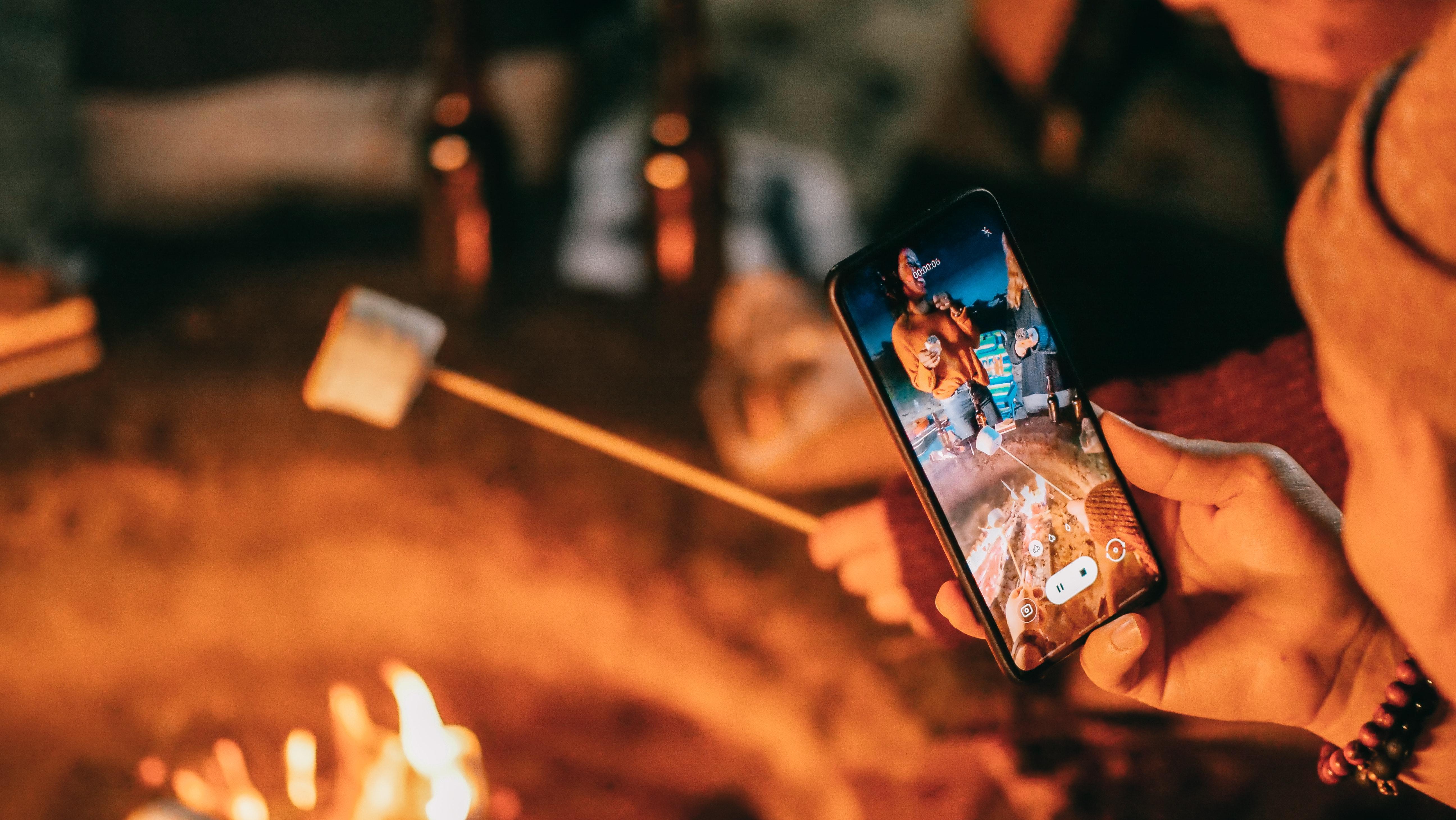 enjoying-the-campfire-while-camping-at-a-beach